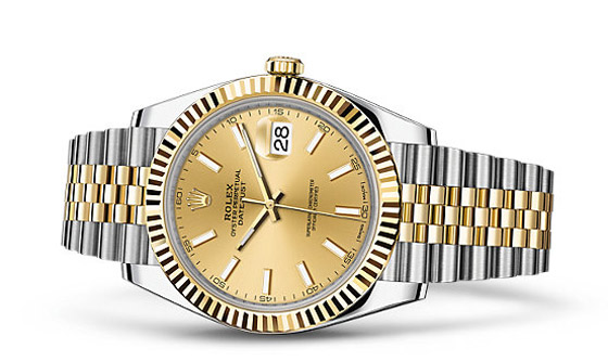 Authentic Rolex Watch with gold dial and fluted bezel