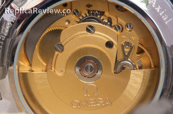 mechanical movement of Omega replica in gold color
