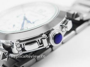 blue cabochon on winding crown of fake cartier