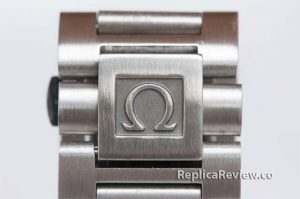 Omega etched logo on band clasp